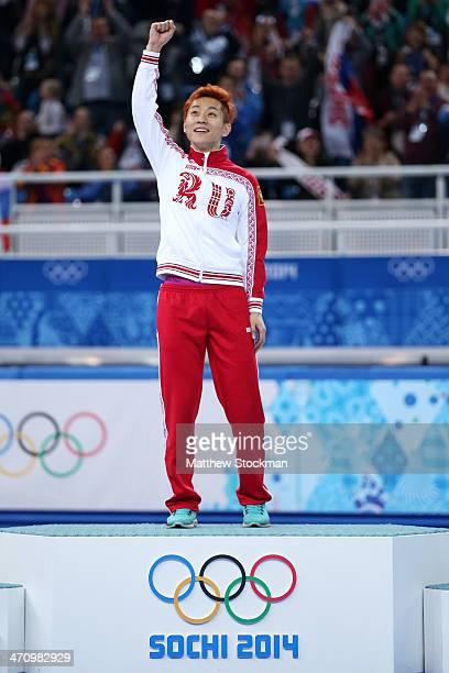 Gold medalist Victor An of Russia celebrates during the flower ceremony for the Short Track Men's 500m on the podium during the flower ceremony for...