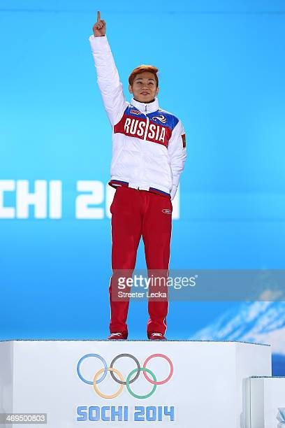 Gold medalist Victor An of Russia celebrates on the podium during the medal ceremony for the Short Track Speed Skating Men's on day 8 of the Sochi...