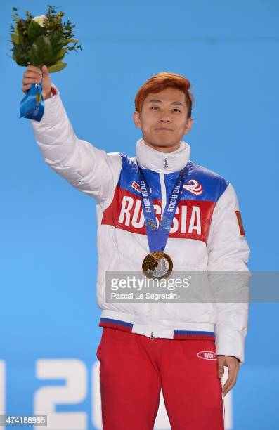 Gold medalist Victor An of Russia celebrates on the podium during the medal ceremony for the Short Track Men's 500m on Day 15 of the Sochi 2014...