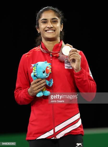Gold medalist Vinesh Vinesh of India poses during the medal ceremony for the women's freestyle 50kg event during Wrestling on day 10 of the Gold...