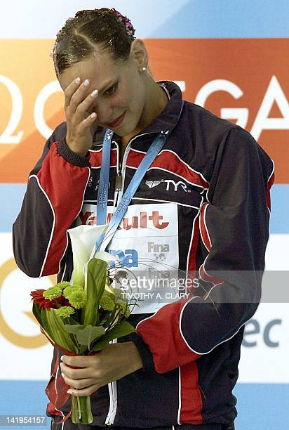Gold medalist Virginie Dedieu of France during the medal ceremony after the synchronized swim free solo finals 21 July 2005 at the 2005 XI FINA World...