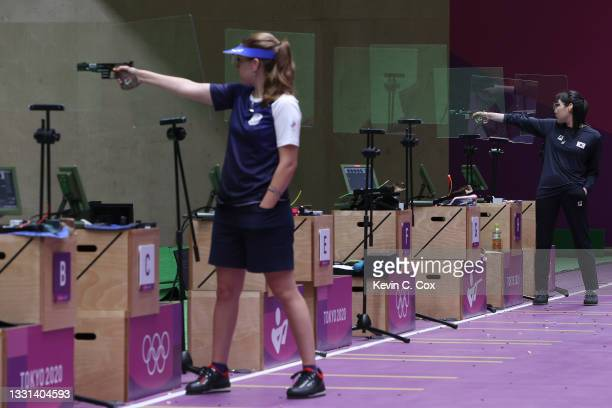 Gold Medalist Vitalina Batsarashkina and Silver Medalist Minjung Kim of Team South Korea compete in 25m Pistol Women's Finals on day seven of the...