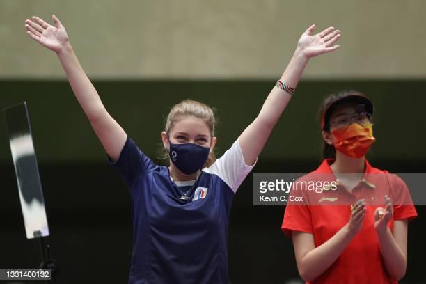 Gold Medalist Vitalina Batsarashkina of Team ROC and Bronze Medalist Jiaruixuan Xiao of Team China following the 25m Pistol Women's Finals on day...