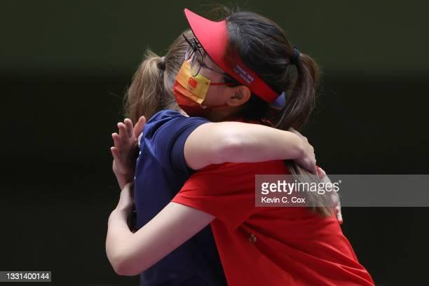 Gold Medalist Vitalina Batsarashkina of Team ROC hugs Bronze Medalist Jiaruixuan Xiao of Team China following the 25m Pistol Women's Finals on day...