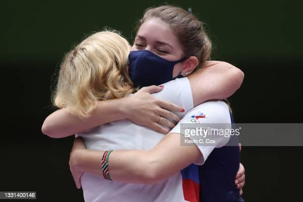 Gold Medalist Vitalina Batsarashkina of Team ROC hugs her coach following the 25m Pistol Women's Finals on day seven of the Tokyo 2020 Olympic Games...