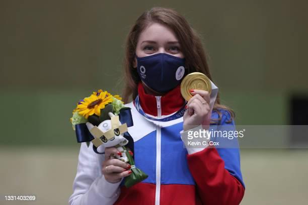 Gold Medalist Vitalina Batsarashkina of Team ROC poses on the podium following the 25m Pistol Women's Finals on day seven of the Tokyo 2020 Olympic...