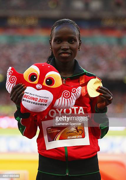Gold medalist Vivian Jepkemoi Cheruiyot of Kenya poses on the podium during the medal ceremony for the Women's 10000 metres final during day four of...