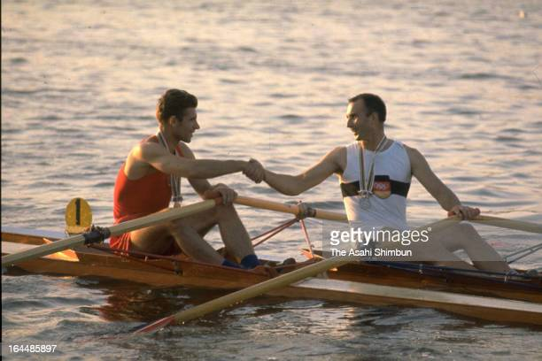 Gold Medalist Vyacheslav Ivanov of Soviet Union shakes hands with Silver medalist Achim Hill of Germany in the Men's Rowing Single Skulls during the...