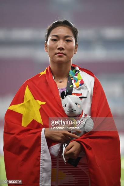 Gold medalist Wang Chunyu of China celebrates on the podium during Women's 800m victory ceremony on day ten of the Asian Games on August 28 2018 in...