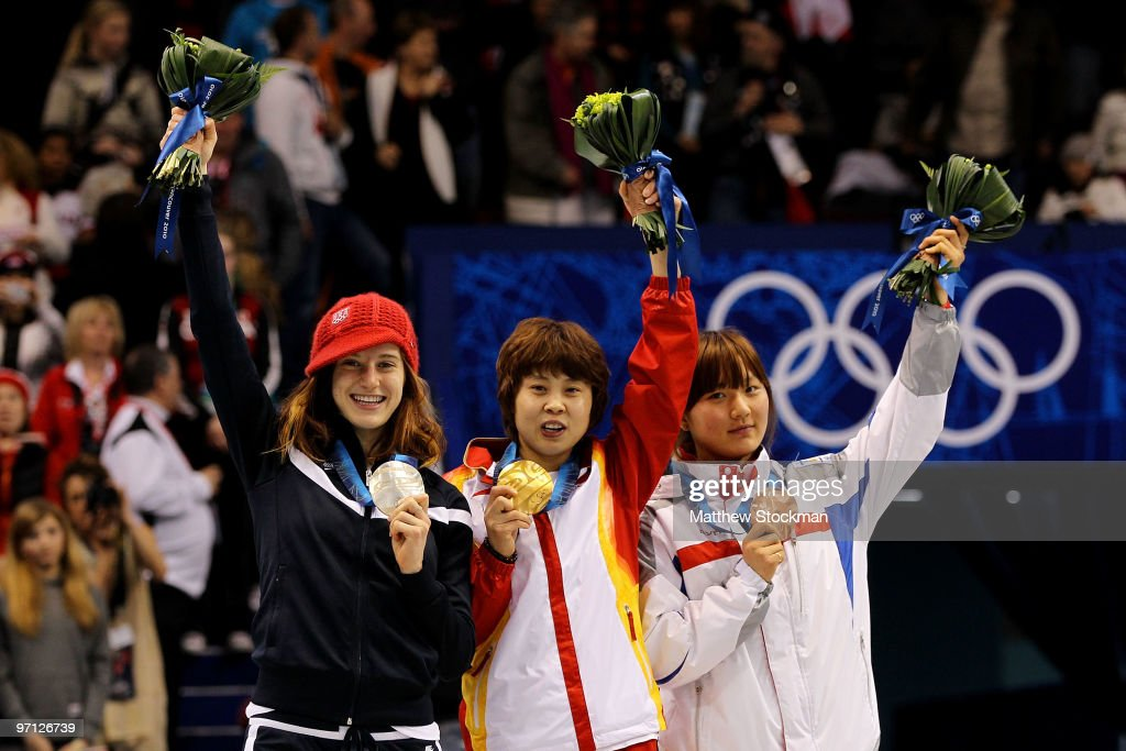 Gold medalist Wang Meng of China celebrates with silver medalist Katherine Reutter of the United States and bronze medalist Park Seung-Hi of South Korea after the Ladies 1000m Short Track Speed Skating Final on day 15 of the 2010 Vancouver Winter Olympics at Pacific Coliseum on February 26, 2010 in Vancouver, Canada.