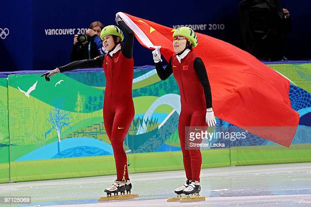 Gold medalist Wang Meng of China celebrates with Zhou Yang in the Ladies 1000m Short Track Speed Skating Final on day 15 of the 2010 Vancouver Winter...
