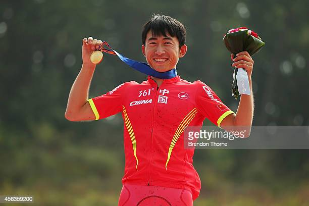 Gold medalist Wang Zhen of China poses atop the podium following the Men's Crosscountry Final during day eleven of the 2014 Asian Games at Yeongjong...