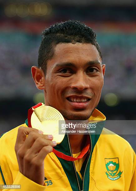Gold medalist Wayde Van Niekerk of South Africa poses on the podium during the medal ceremony for the Men's 400 metres final during day six of the...