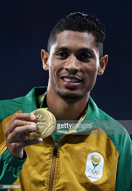 Gold medalist Wayde van Niekerk of South Africa poses on the podium during the medal ceremony for the Men's 400 metres on Day 10 of the Rio 2016...