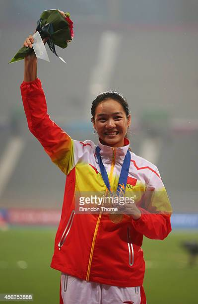Gold medalist Wei Yongli of China celebrates on the podium during the victory ceremony for the Women's 100m during day nine of the 2014 Asian Games...