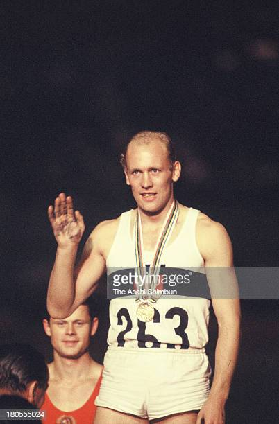 Gold Medalist Willi Holdorf of Germany on the podium at the Men's Decathlon Medal Ceremony during the Tokyo Olympics at the National Stadium on...