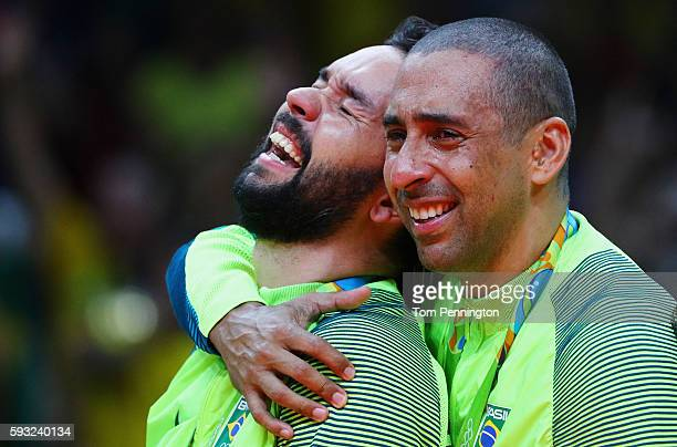 Gold medalist, William Arjona of Brazil celebrates with Sergio Dutra Santos of Brazil during the medal ceremony after the Men's Gold Medal Match...