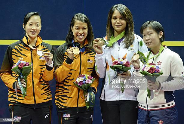 Gold medalist winner Malaysia's Nicol Ann David silver medalist Malaysia's Wee Wern Low and bronze medalists India's Dipika Rebecca Pallikal and Hong...