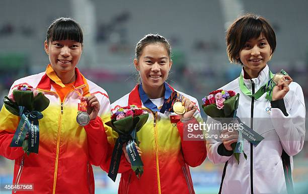 Gold medalist Wu Shuijiao of China Silver medalist Sun Yawei of China and Bronze medalist Ayako Kimura of Japan pose during the medal ceremony of the...
