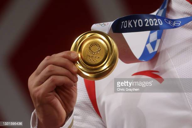 Gold medalist Xiaojun Lyu of Team China poses with the gold medal during the medal ceremony for the Weightlifting - Men's 81kg Group A on day eight...