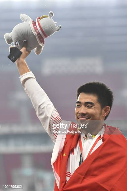 Gold medalist Xie Wenjun of China celebrates on the podium during Men's 110m Hurdles victory ceremony on day ten of the Asian Games on August 28 2018...