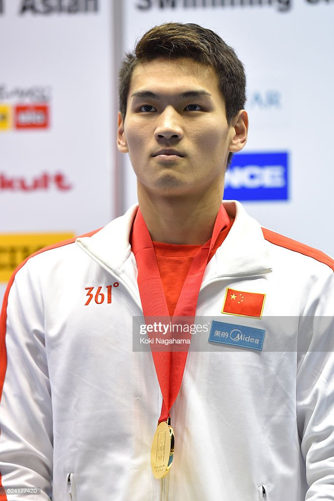 Gold medalist Xu Jiayu of China stands for his national anthem after Men's 200m Backstoke final race during the 10th Asian Swimming Championships 2016 at the Tokyo Tatsumi International Swimming Center/Tokyo Metropolitan Swimming Pool on November 18, 2016 in Tokyo, Japan.