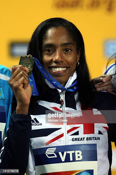 Gold medalist Yamile Aldama of Great Britain stands on the podium during the medal ceremony for the Women's Triple Jump during day two of the 14th...