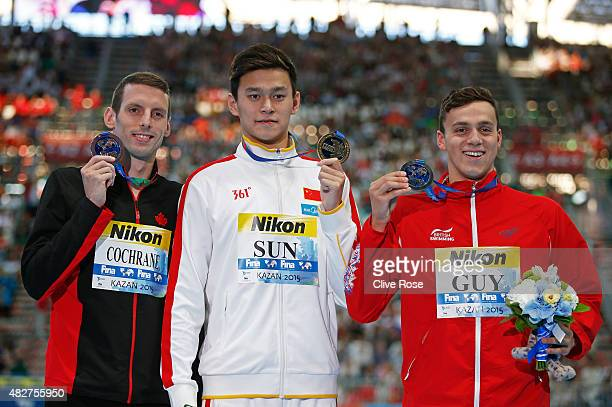 Gold medalist Yang Sun of China poses with silver medalist James Guy of Great Britain and bronze medalists Ryan Cochrane of Canada during the medal...