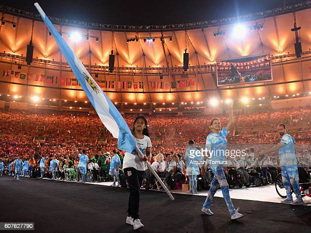 Gold medalist Yanina Martnez carries the flag for Argentina during the closing ceremony of the Rio 2016 Paralympic Games at Maracana Stadium on...