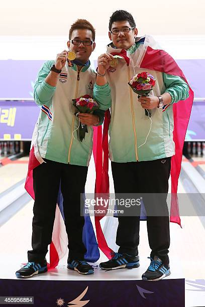 Gold medalist Yannaphon Larp Apharat of Thailand and Bronze medalist Sithiphol Kunaksorn of Thailand pose atop the podium following Group B of the...