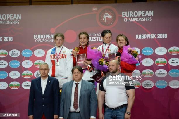 Gold medalist Yasemin Adar of Turkey, silver medalist Ekaterina Bukina of Russia and bronze medalists Vasilisa Marzaliuk of Belarus and Sabira...