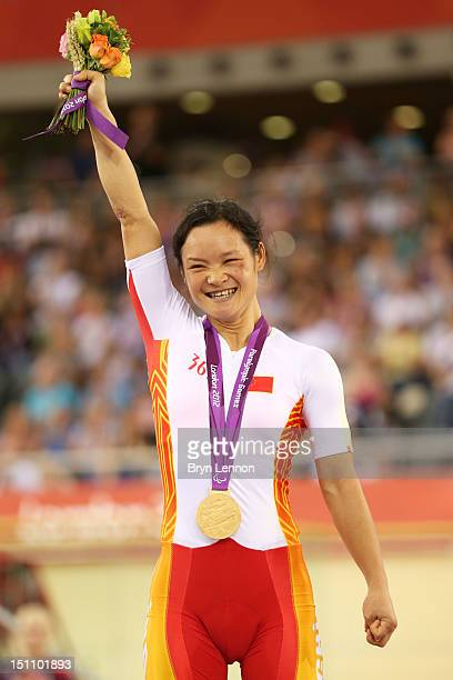 Gold medalist Yin He of China poses on the podium during the medal ceremony in the Women's Individual C123 500m Cycling Time Trial on day 3 of the...