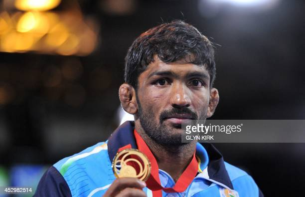 Gold medalist Yogeshwar Dutt of India poses with his medal after the Men's Freestyle 65kg Freestyle Wrestling Gold medal match at the SECC 2014...