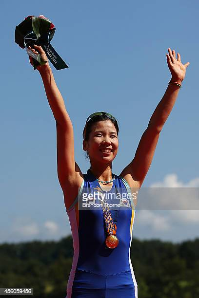 Gold medalist Yoojin Ji of South Korea celebrates following the Lightweight Women's Single Sculls Final during day six of the 2014 Asian Games at the...