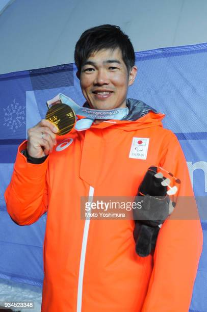 Gold medalist Yoshihiro Nitta of Japan poses for photographs after the medal ceremony for the Men's 10 km Standing Classic on day eight of the...