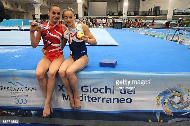 Gold medalist Youna Dufournet of France and bronze medalist Pauline Morel of France pose with their medals after Women's Individual AllAround...