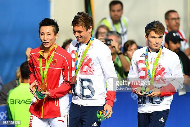 Gold medalist Yue Lin of China and bronze medalists Tom Daley of Great Britain congratulate each other during the medal ceremony for the Men's Diving...