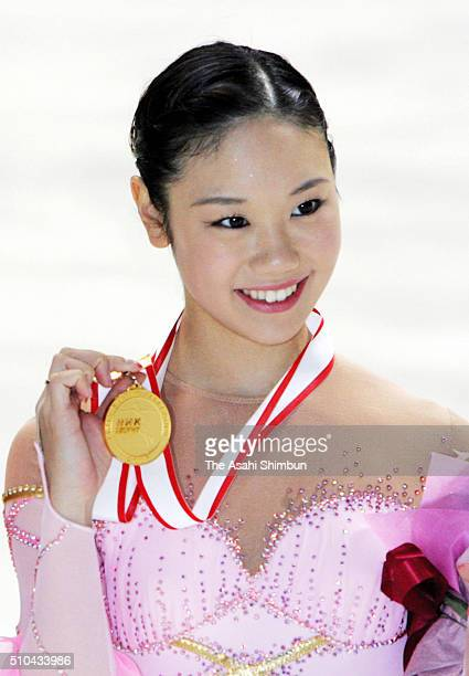 Gold medalist Yukari Nakano of Japan celebrates at the medal ceremony for the Women's Singles during day three of the ISU Figure Skating Grand Prix...
