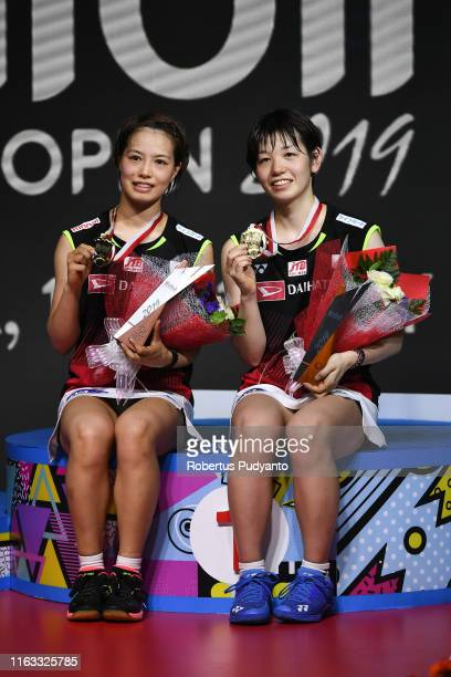 Gold medalist Yuki Fukushima and Sayaka Hirota of Japan celebrate on the podium during the Women's Doubles awarding ceremony on day six of the Bli...