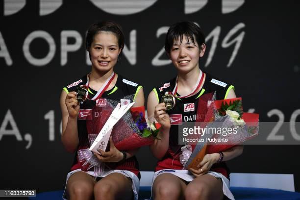 Gold medalist Yuki Fukushima and Sayaka Hirota of Japan celebrate on the podium during the Women's Doubles awarding ceremony on day six of the Bli...
