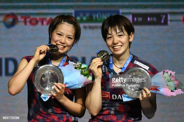 Gold medalist Yuki Fukushima and Sayaka Hirota of Japan pose with their medals during the Women's Doubles awarding ceremony on day six of the Blibli...