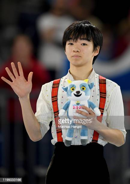 Gold medalist Yuma Kagiyama of Japan poses for a photo during the mascot ceremony following Men Single Skating Free Skating during day 3 of the...