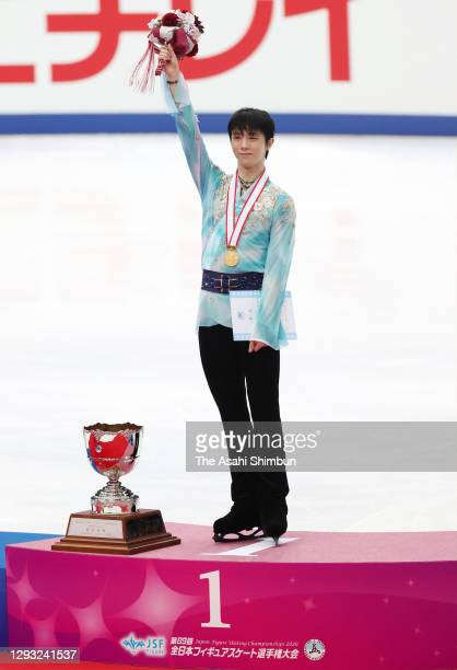 Gold medalist Yuzuru Hanyu applauds fans at the medal ceremony for the Men's Single on day two of the 89th All Japan Figure Skating Championships at...