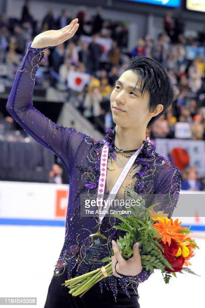 Gold medalist Yuzuru Hanyu of Japan applauds fans after the medal ceremony in the Men's Singles during the ISU Grand Prix of Figure Skating Canada at...