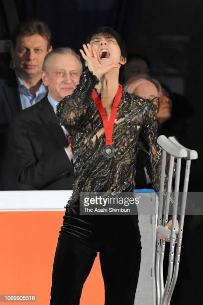 Gold medalist Yuzuru Hanyu of Japan applauds fans after the medal ceremony for the Men's Singles on day three of the ISU Grand Prix of Figure Skating...