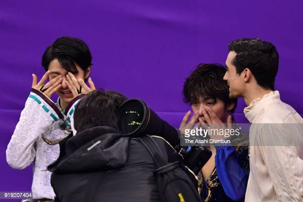Gold medalist Yuzuru Hanyu of Japan bronze medalist Javier Fernandez of Spain and silver medalist Shoma Uno of Japan embrace before the victory...