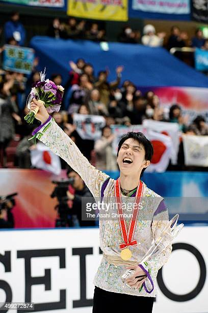 Gold medalist Yuzuru Hanyu of Japan celebrates after the medal ceremony for the Men's Singles during day two of the NHK Trophy ISU Grand Prix of...