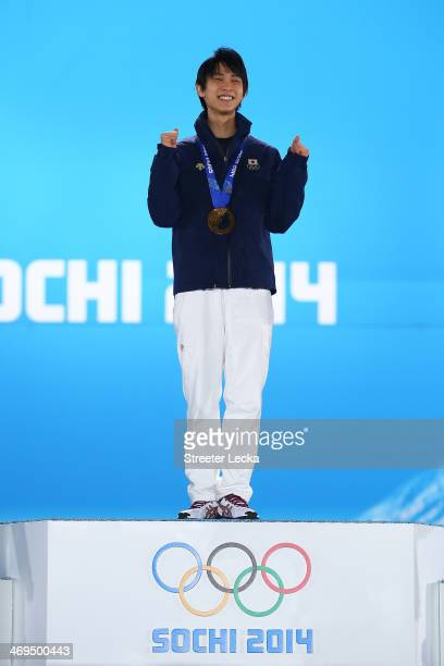 Gold medalist Yuzuru Hanyu of Japan celebrates during the medal ceremony for the Men's Figure Skating on day 8 of the Sochi 2014 Winter Olympics at...