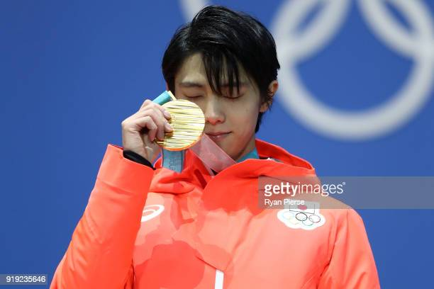 Gold medalist Yuzuru Hanyu of Japan celebrates during the medal ceremony for the Men's Figure Skating - Single Free Skating on day eight of the...