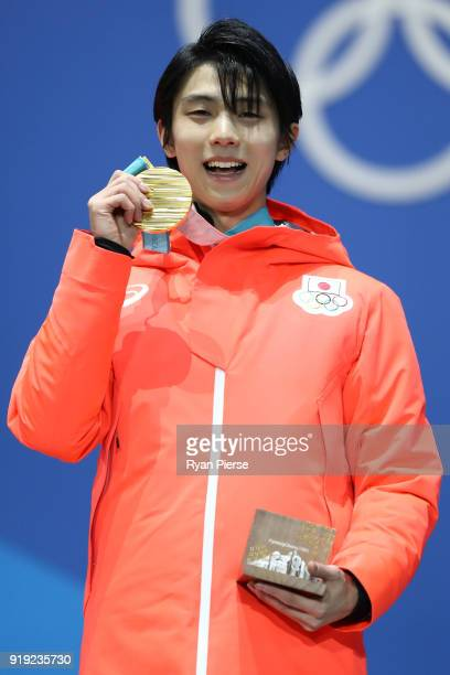 Gold medalist Yuzuru Hanyu of Japan celebrates during the medal ceremony for the Men's Figure Skating Single Free Skating on day eight of the...